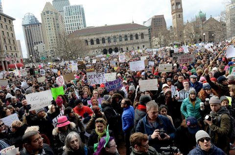 People gather in Boston's Copley Square to protest the immigration ban enacted by President Trump.